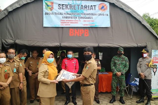 Bupati Dewi Handajani Kembali Salurkan Bantuan dari ASN Tanggamus