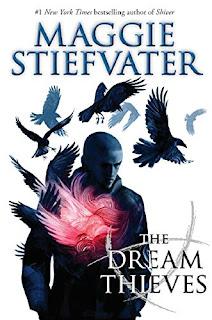 A serious-looking white boy with a shaved head and dark jacket has a red glow from his chest as a bunch of ravens fly out of him