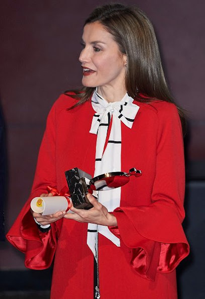 Queen Letizia wore a Zara Frilled Sleeve Coat and Roberto Verino Blouse, Carolina Herrera black-patent and suede pumps and carried Carolina Herrera Animal Print Clutch Bag