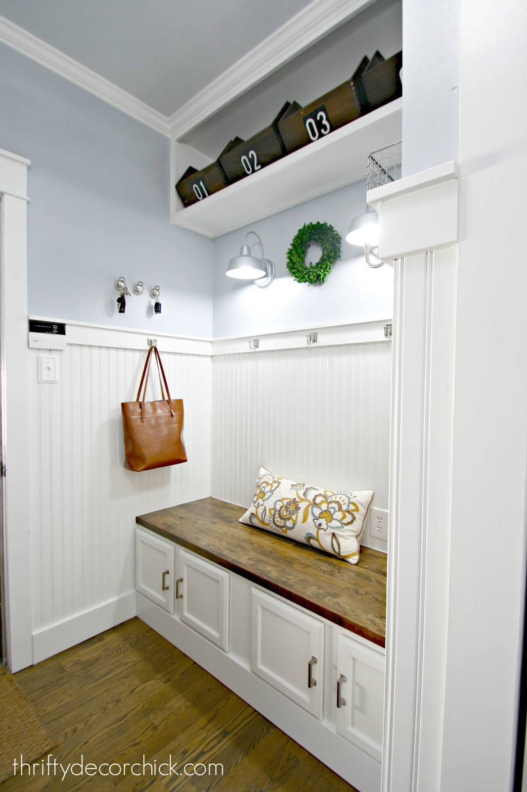 Pretty DIY mud room bench with cabinets