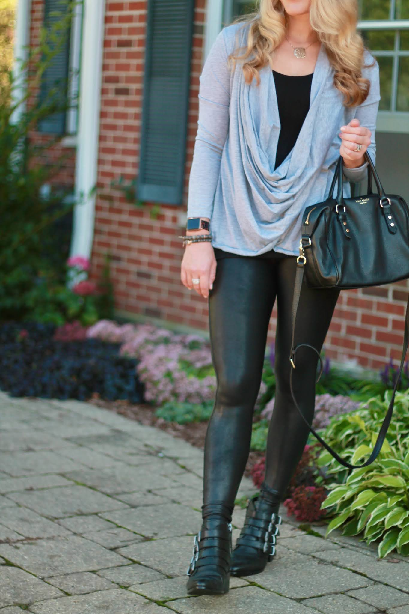 fall outfit with leather leggings, spanx leather leggings, black buckle booties, grey crossover top, fall leggings outfit