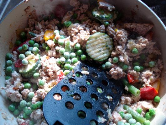 Add frozen vegetables, stir