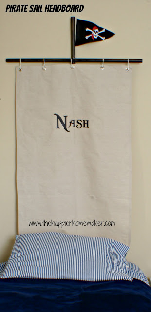 """A pirate sail headboard with the name \""""Nash\"""" on it"""
