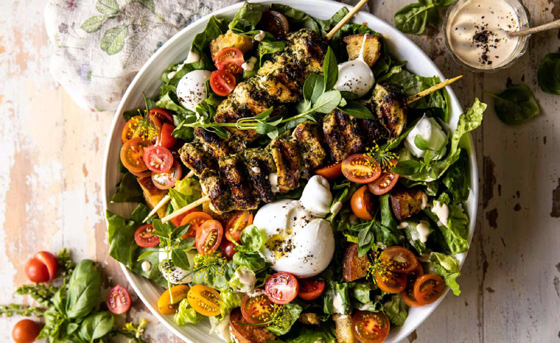 Pesto Chicken Caesar Salad with Tomatoes and Burrata