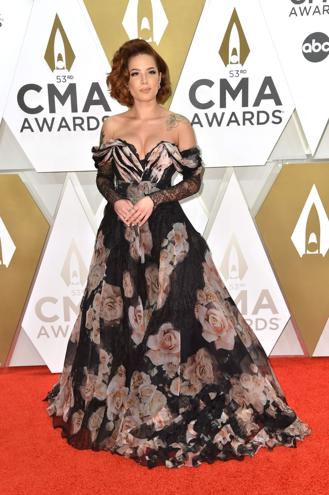 Halsey stuns in plunging black off-the-shoulder floral gown and ginger tresses at the CMA Awards in Nashville