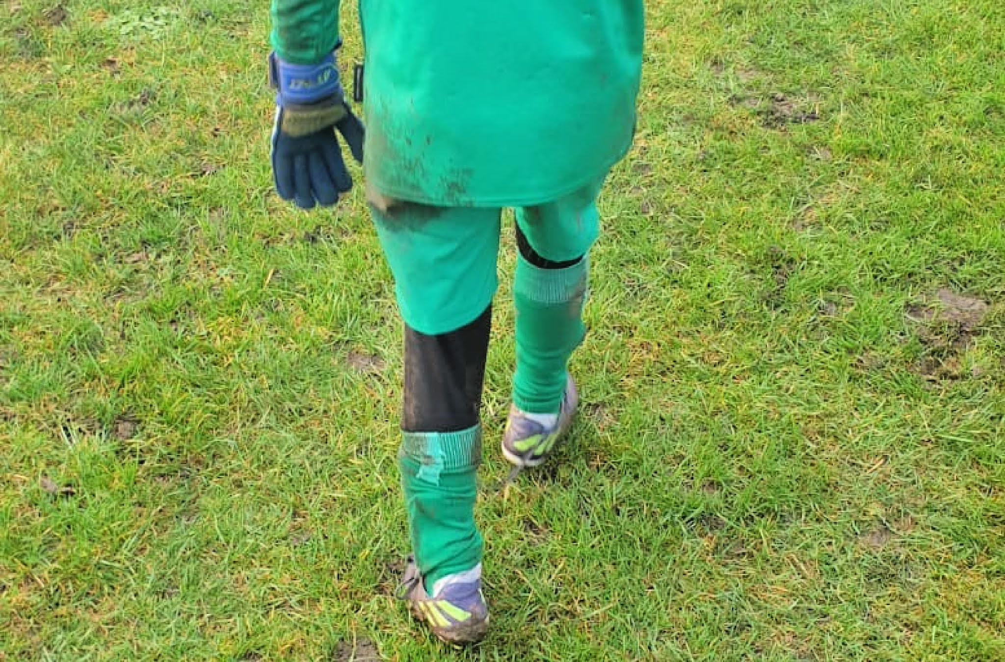boy with muddy football boots