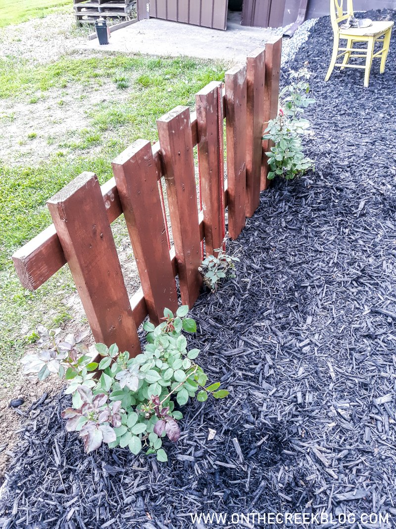 Rustic fence with climbing roses | On The Creek Blog