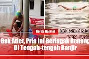 Bak Atlet, Pria Ini Berlagak Renang Di Tengah-tengah Banjir