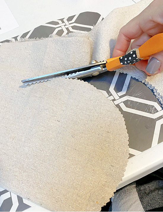 cutting a heart from drop cloth fabric