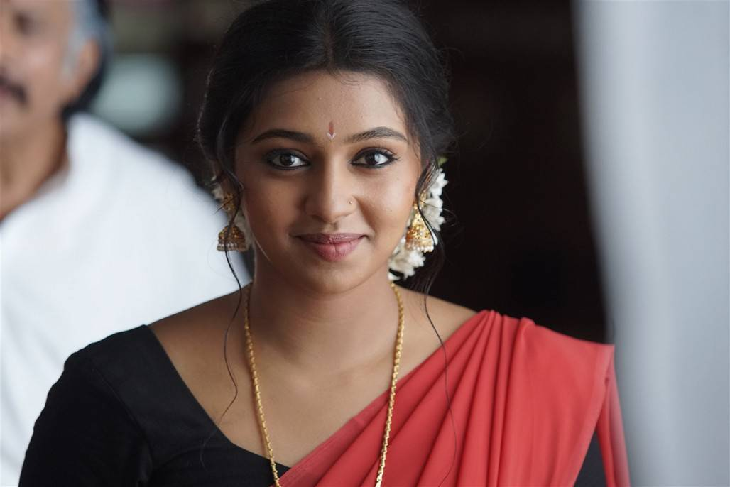 Glamours Tamil Girl Lakshmi Menon Photos In Red Lahenga Voni Half Sari