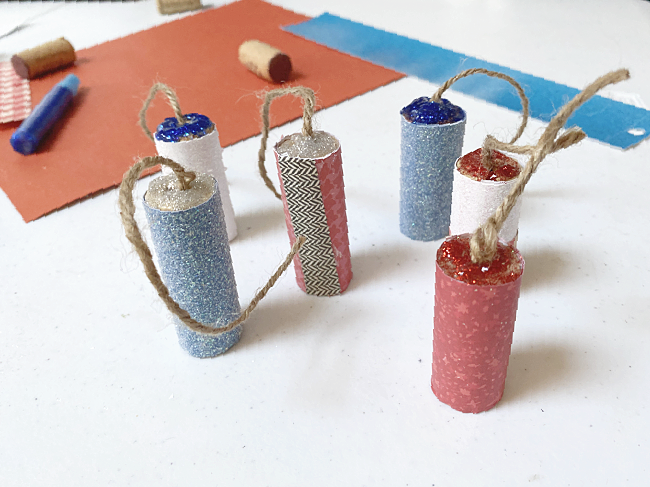 cork wrapped with scrapbook paper