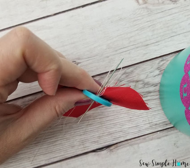 how to sew a button using a sewing machine