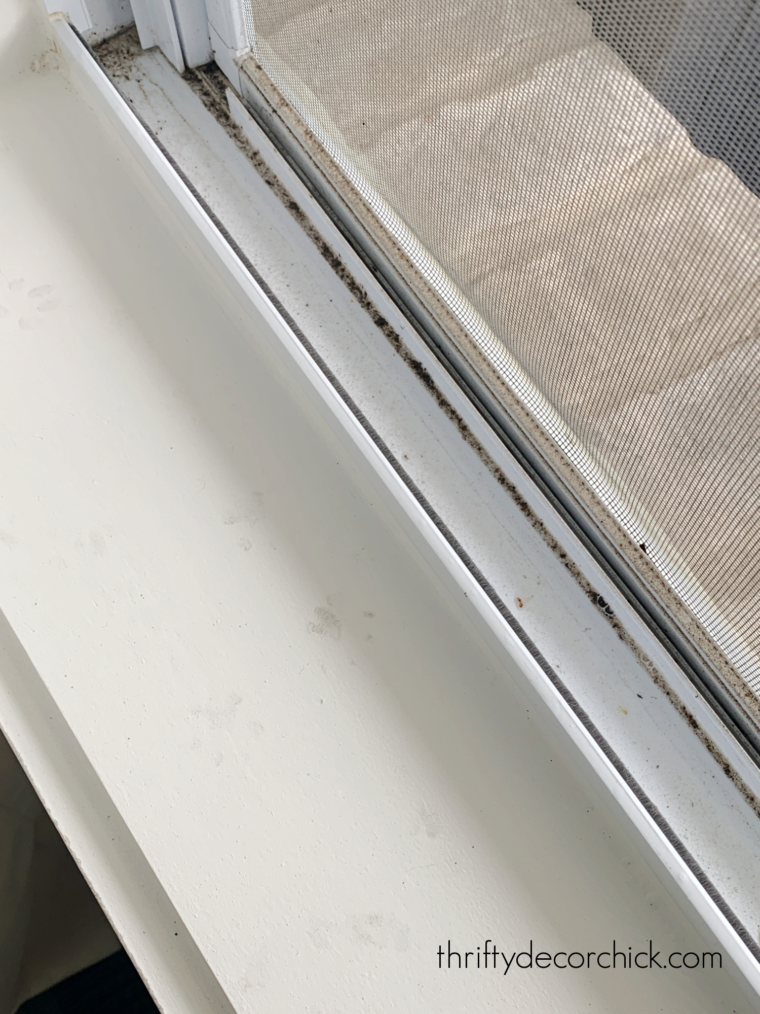 dirty window sill cleaning