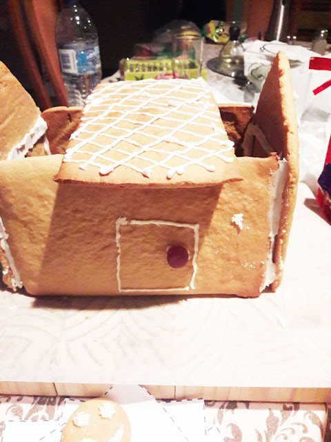 Building our Gingerbread House. Walls up Roof off
