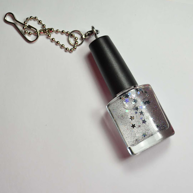 mini nail polish bottle with decorative glitter