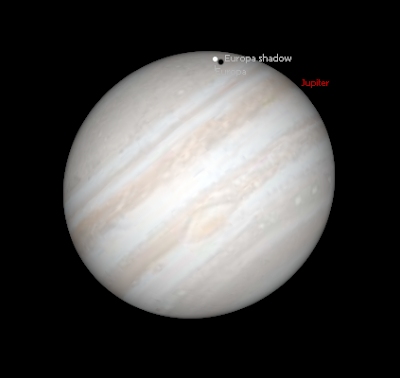 simulated view of Jupiter and Europa