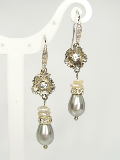 Silver, crystal and pearl drop earrings in neutral shades of grey and cream.
