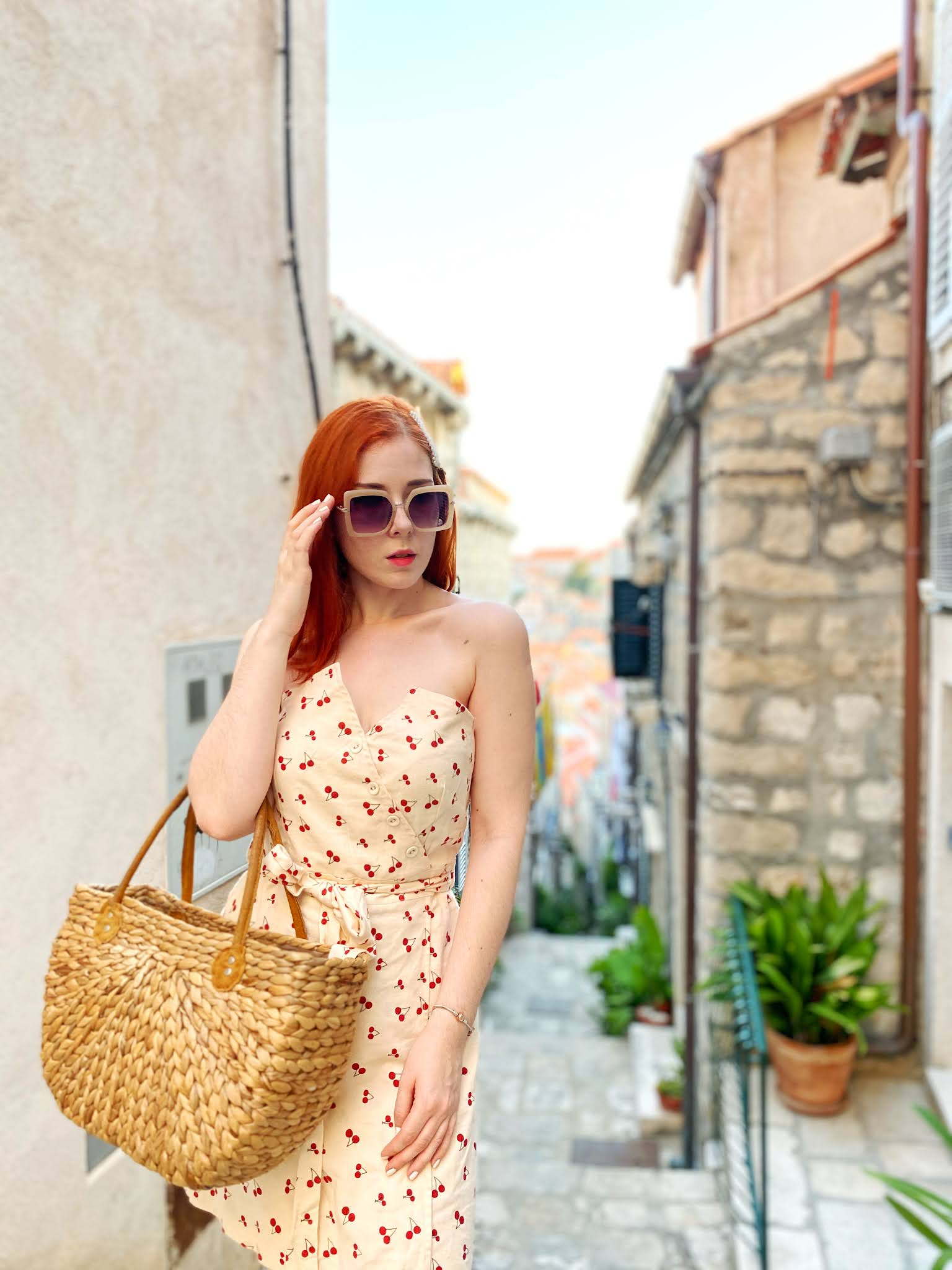 redhead wearing summer dress with cherries