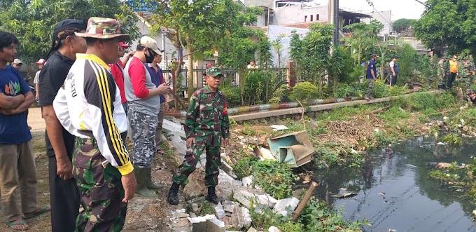 Koramil 06/Setu Karya Bakti Bersama Warga Desa Lubang Buaya