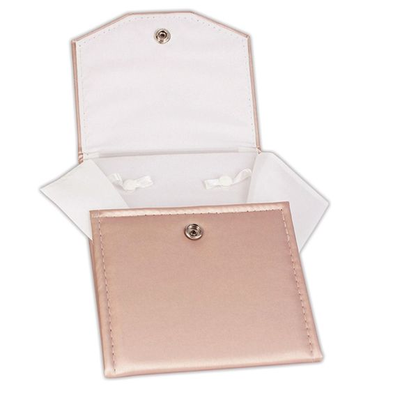 Champagne-colored jewelry leatherette holder.