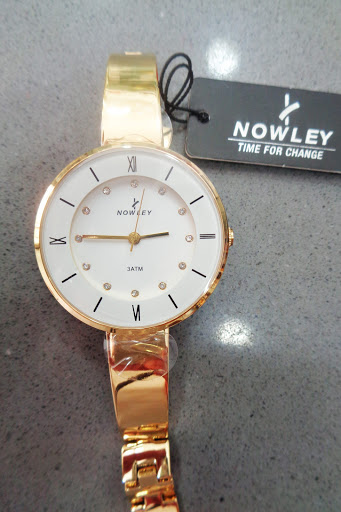 Reloj de acero dorado Nowley para chica
