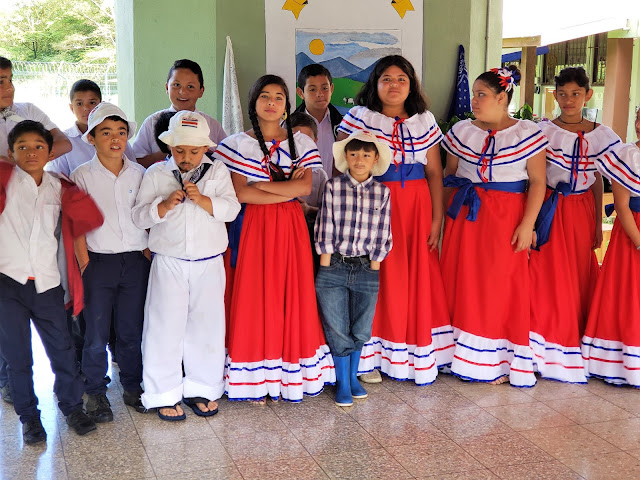 Students wearing traditional clothing.