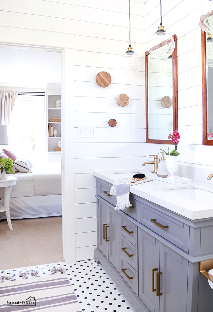 white and grey bathroom with wooden accents