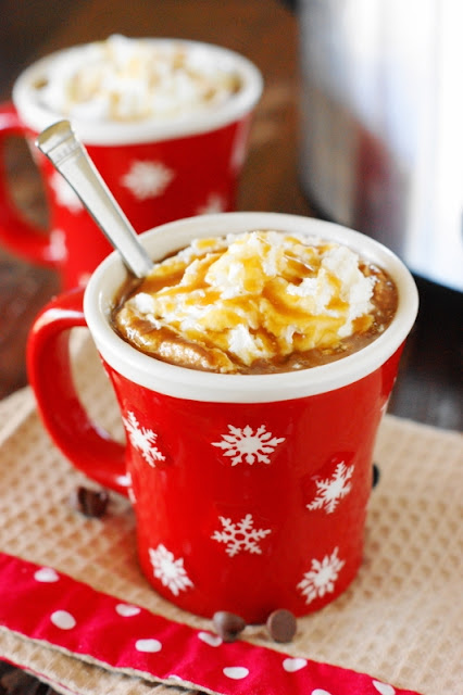 recipes for twenty super delicious hot drinks to warm you up during fall or winter! Try this slow cooker caramel hot chocolate that the kids will love!