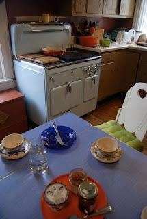 Vintage blue Chambers model C high back set in modest kitchen in Millbrook, New York