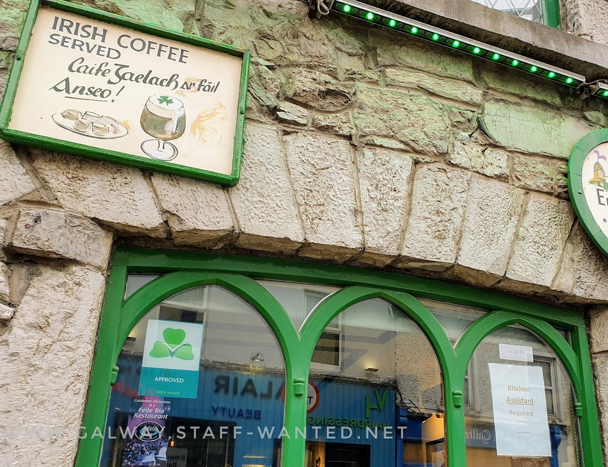 restaurant window with a sign above it saying that Irish coffee is served here - in English and Gaelic viz caife gaelach ar fáil Anseo