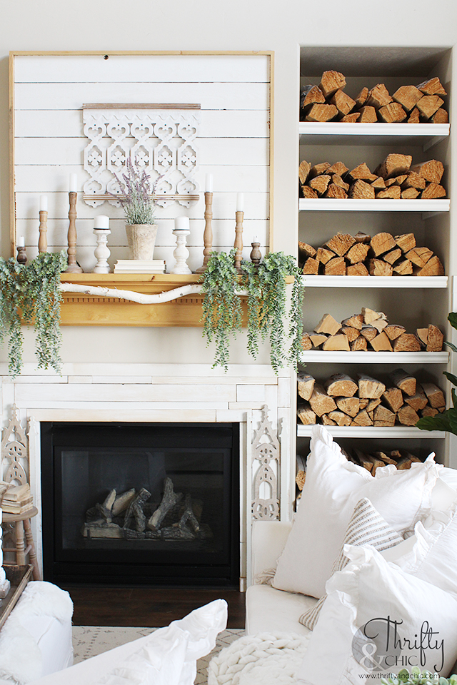 farmhouse style spring living room decor. Spring living room decorating ideas. White and woods living room decor. spring decorating ideas for the home. Two story living room decor. Bookshelf styling . Spring mantle decorating ideas. Neutral living room decor