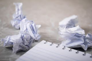 crumpled writing paper