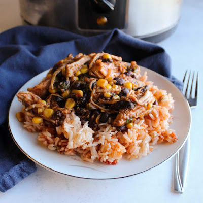 plate of Mexican rice piled high with salsa chicken