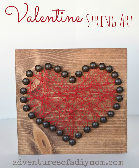 heart string art using wood, upholstery tacks and string