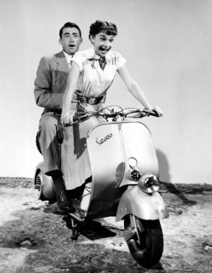 Audrey Hepburn on scooter in Roman Holiday