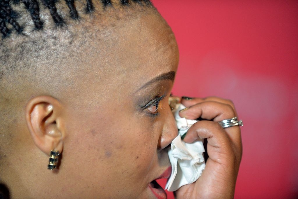 South African comedian Tumi Morake weeps during the Savanna Comics Choice Awards at the Teatro, Montecasino on September 03, 2016 in Johannesburg, South Africa. Now in its sixth year, the event bring an entertaining and hilarious show including celebrity performances and stand-up comedy. (Photo by Frennie Shivambu/Gallo Images/Getty Images)