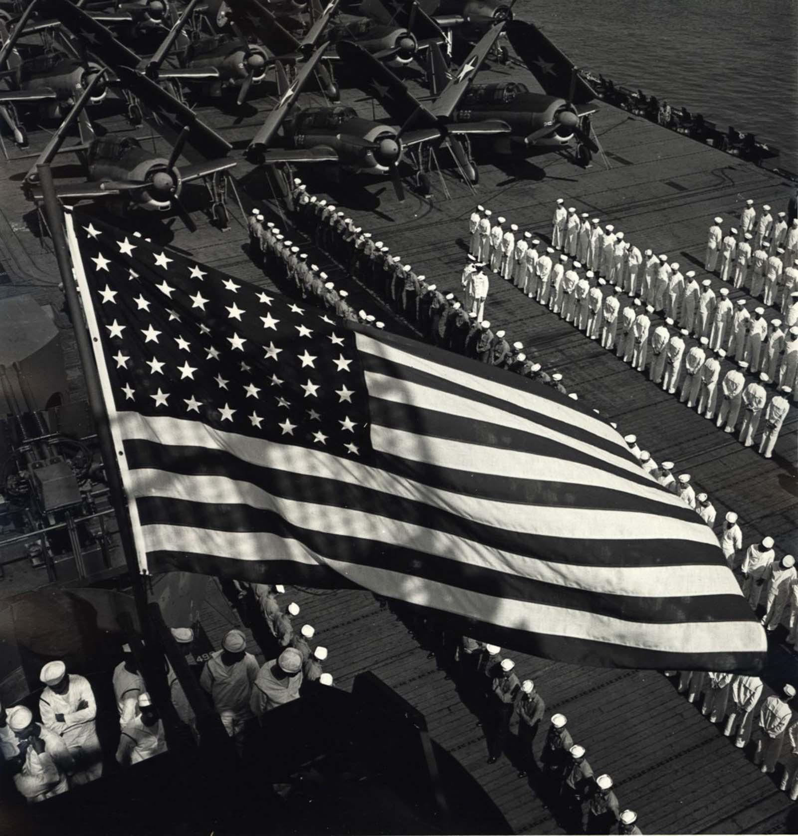 U.S. Navy under American flag, c. 1943.