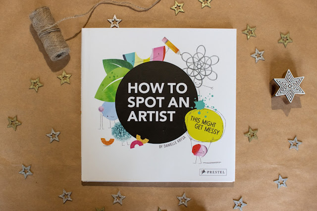 """A square hardback book with the title """"How To Spot An Artist"""" ready to be wrapped as a christmas present for a 5 year old"""