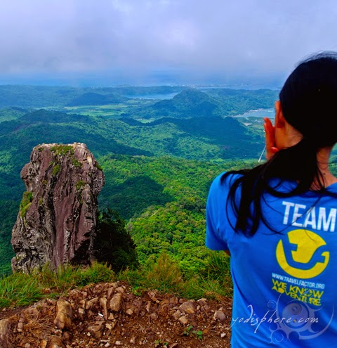 Travel Factor organizer enjoying the view of the monolith from the summit of Mt. Pico de Loro  hover_share