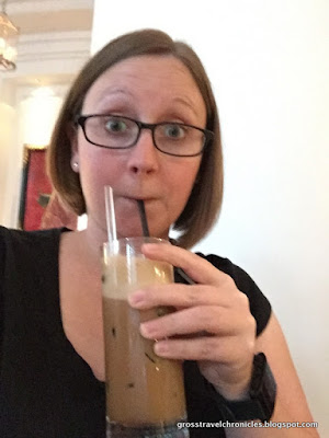 Liz enjoying an iced coffee at the hotel cafe