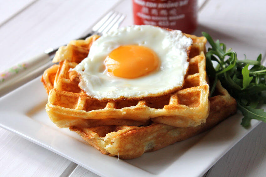 Savoury waffles on a plate served with a fried egg