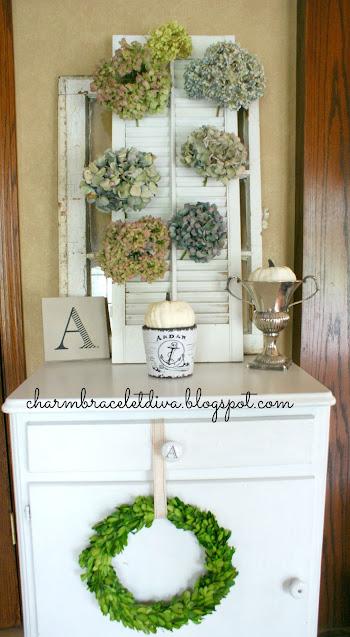 Dried hydrangeas vintage shutter candle boxwood wreath