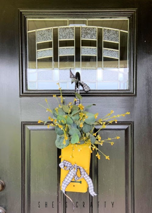 New uses for vintage goods in home decor  | mailbox door hanger for flowers