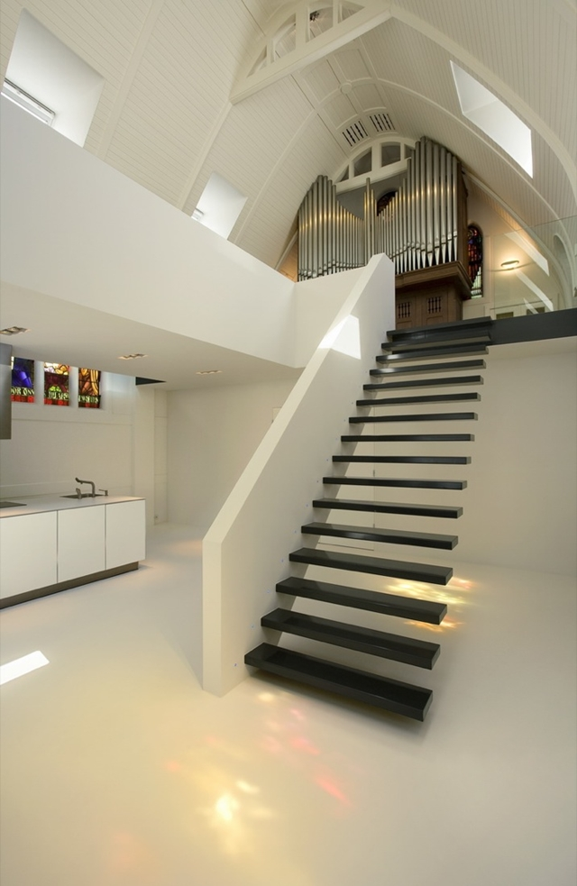 Black minimal staircase to the upper floor