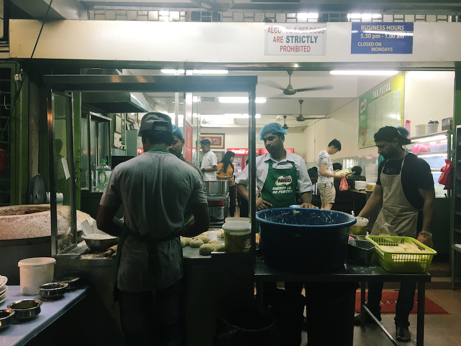 Cooks preparing chicken at pak putra tandoori
