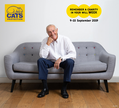 Len Goodman sitting on sofa with Cats Protection and Remember A Charity Week logos