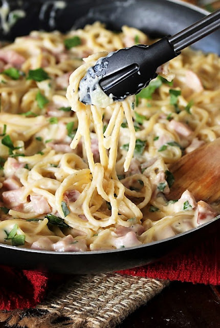 Serving Creamy Ham & Cheese Spaghetti with Tongs Image