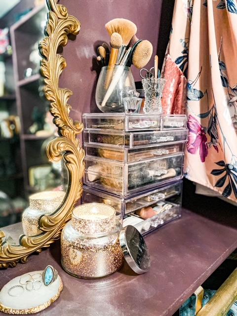 vintage gold mirror in closet