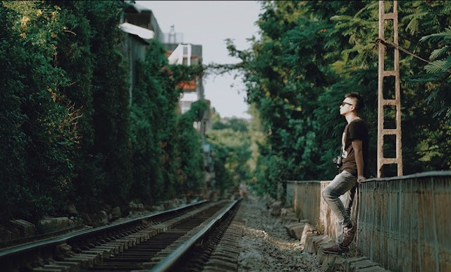 The tree-lined train road in the heart of Hanoi attracts young people
