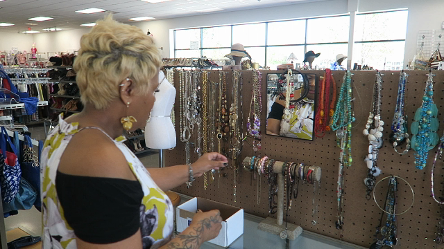 Image: Woman ( Tangie Bell) shopping at the thrift store and sharing her fun and weird life.